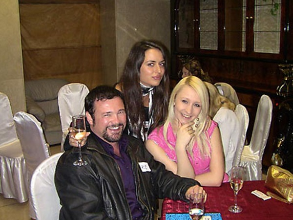 A photo of a foreign man with beautiful women from Kiev Ukraine