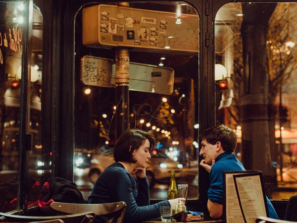 A couple savoring a romantic dinner date at a restaurant in Kiev Ukraine